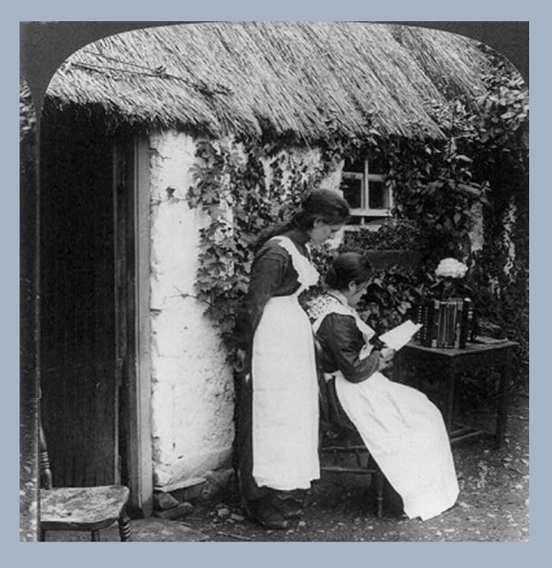 Irish women reading letters from America in front of a thatched cottage.