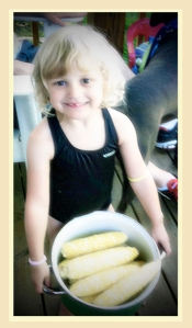 Little girl with a pan of corn #children #corn #summer #girls