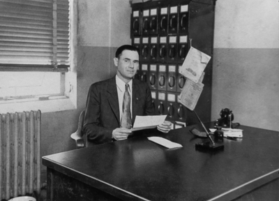 Frederick Helveston at his office desk. #Helvenston family #Frederick Helveston